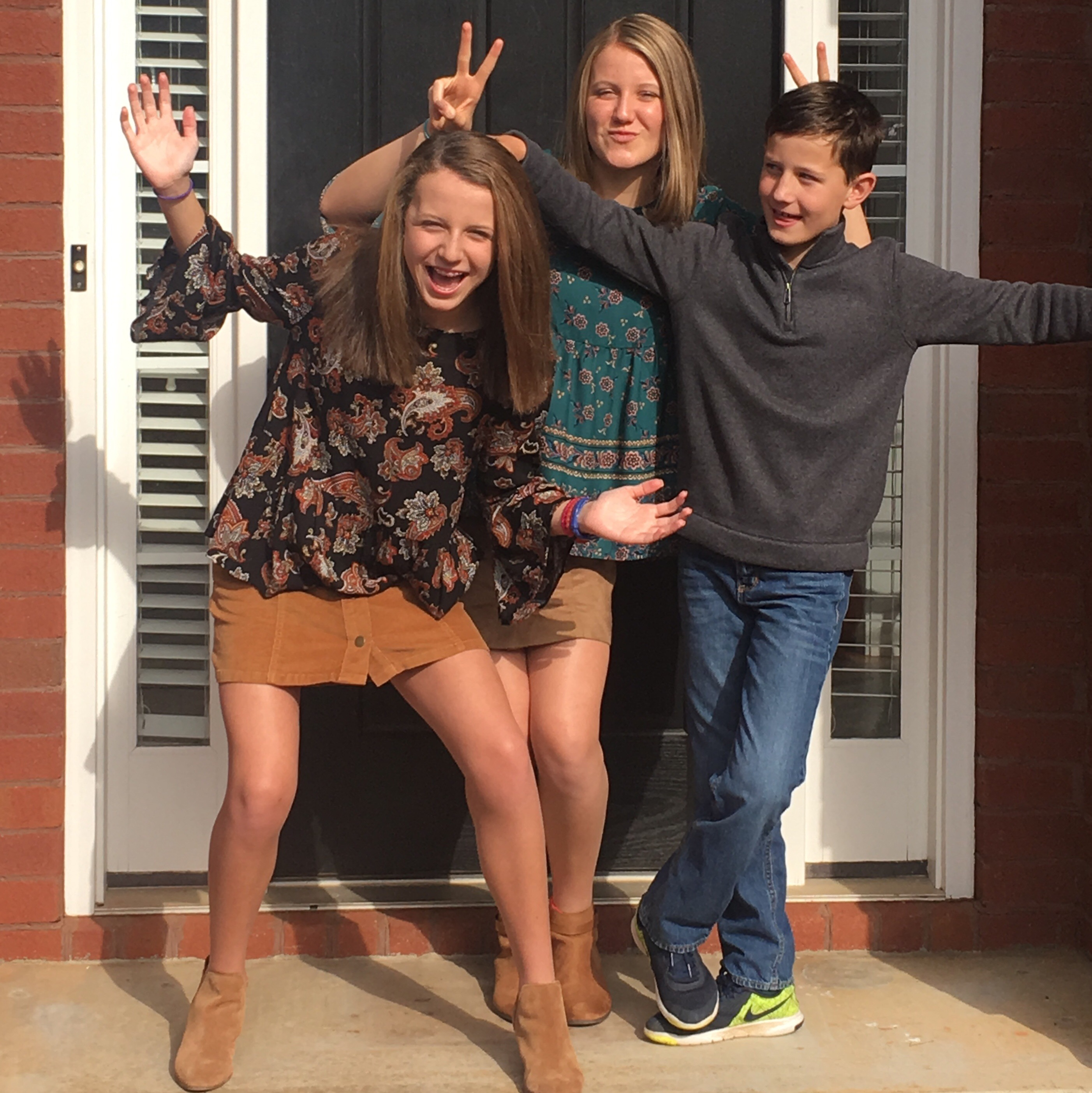 My two nieces and my nephew being super silly on Thanksgiving in the family photo.