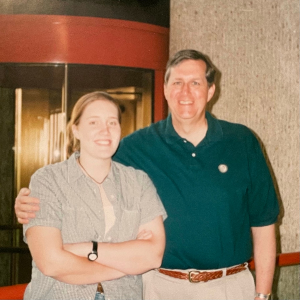 A picture of my dad and me in the lobby of a hotel in San Antonio.